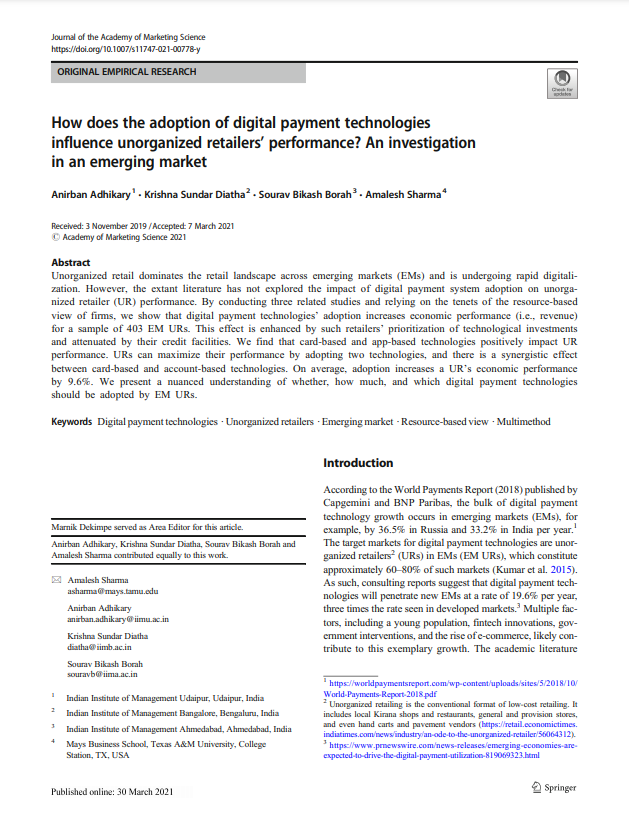 How does the adoption of digital payment technologies influence unorganized retailers' performance? An investigation in an emerging market