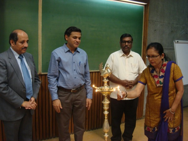Lighting the Ceremonial Lamp by Ms Hima Soni, Depty Librarian at IIMA